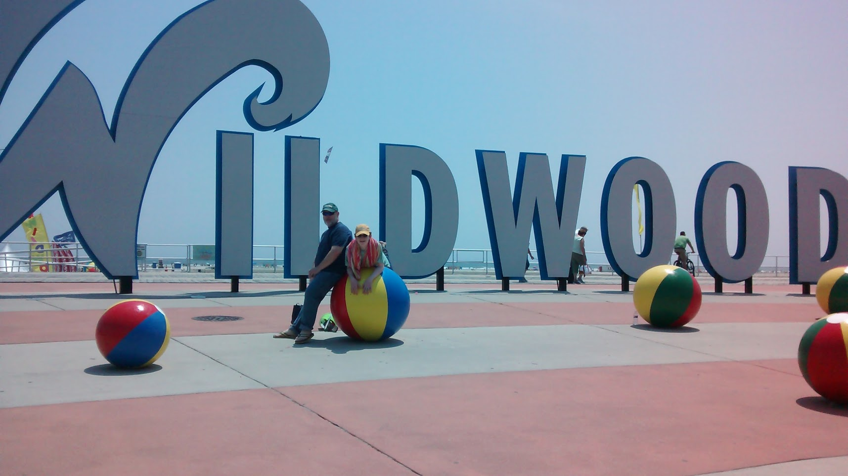 Photo of Carl and Nate in front of The Wildwoods sign